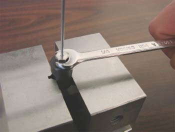 Compression fitting assembly using a pre-swage tool in a vise